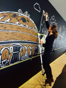 Hannah wields the magic on the chalk board NGS London